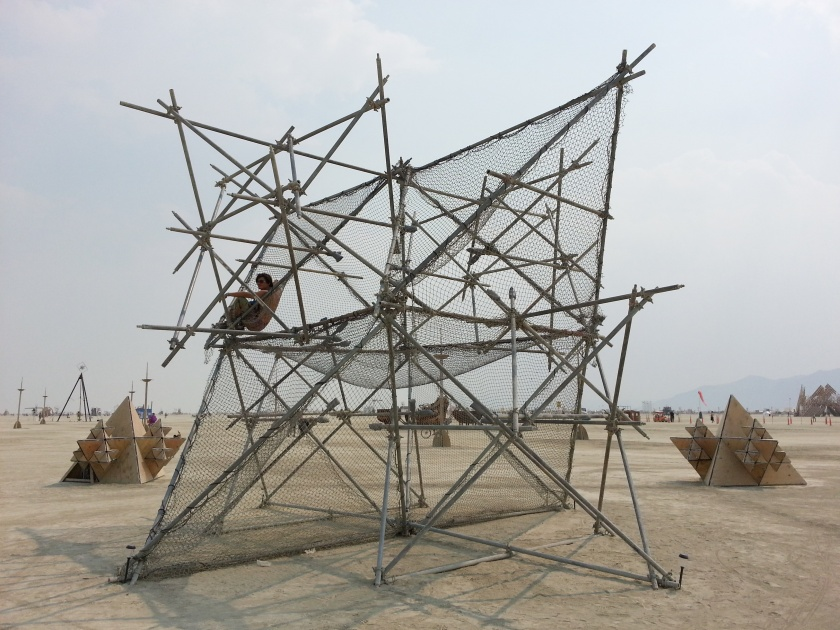 A burner relaxing on the Fractal Cult scaffolding