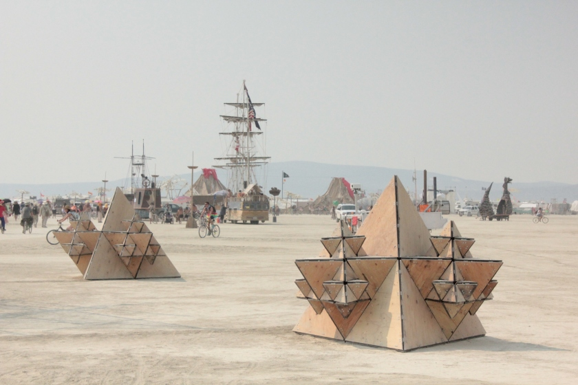 View of timber pods and festival in background
