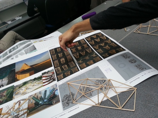 John Konings looking at bamboo structures