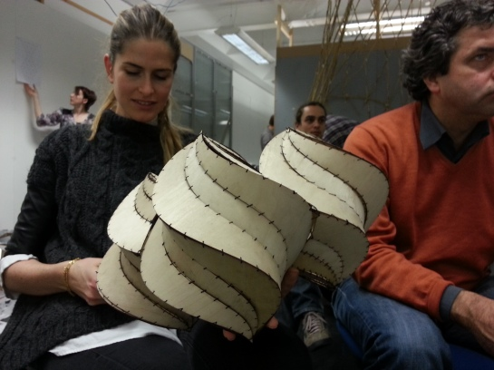 Marie de Monseignat is holding the Plywood Spiralohedrons