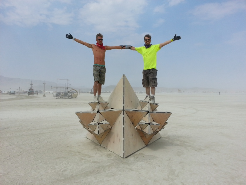 Toby and Arthur standing on Fractal Cult at the Burning Man Festival