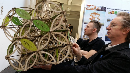 Joe Leach showing his Burning Man proposal model  to  Mike Tonkin